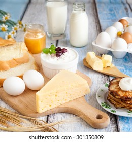 Dairy products: milk, beaded cottage cheese, butter, yogurt, cheese, sour cream. With pancakes, bread, honey and fresh eggs