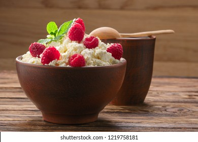 Dairy products: milk, cottage cheese, raspberry and mint. Copy space background
