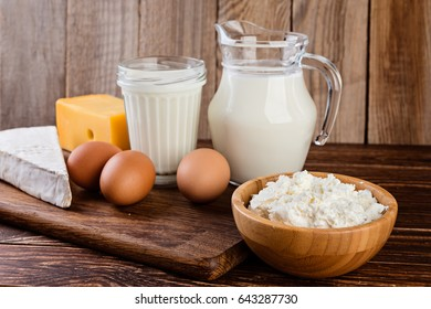 Dairy products on a rustic wooden table. Milk, cheese and eggs.