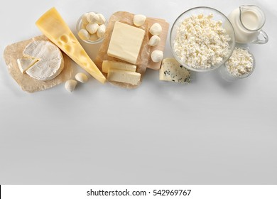 Dairy products on white background, top view