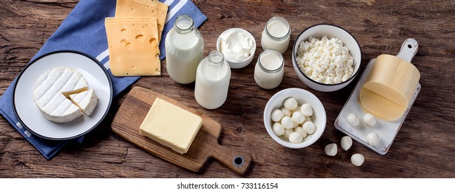Dairy products on wooden background. View from above