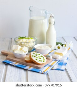 Dairy products on wooden table. Sour cream, milk, cheese, cottage cheese, yogurt and butter.