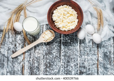 Dairy products on wooden table. Milk, cheese, egg. Top view with copy space.