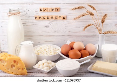 Dairy products on wooden table. Milk, sour cream, cheese, egg, yogurt and butter. Healthy food, diet concept. Copy space