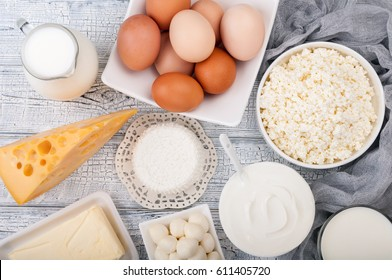 Dairy products on wooden table. Milk, sour cream, cheese, egg, yogurt and butter. Healthy food, diet concept. Copy space. Top view
