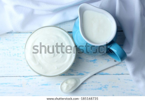 Dairy products on wooden table background