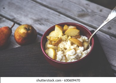 Dairy rice porridge with caramelized pear. Selective focus