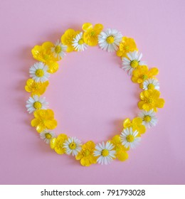 Daisy and Buttercup Wreath of Flowers on Pastel Pink Background with Copy Space - Flat Lay