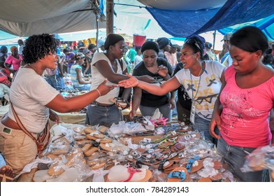 Dajabon / Haiti - July 15, 2011: African American women haggling over sale of used shoes at market on border of Haiti and Dominican Republic.