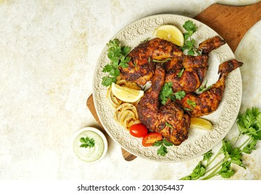 Dajaj Mashwi or Arabian Grilled Chicken is a typical Arabic chicken dish prepared by roasting chicken marinated in yogurt and spices, baked in the oven. Similar to Tandoori Chicken from India.
