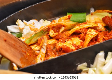 """""""Dak Galbi"""" one of the popular Korean dishes, stir fried vegetables, chicken and Korean curry (Gochujang) in a large hot pan."""
