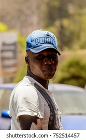 DAKAR, SENEGAL - APR 23, 2017: Unidentified Senegalese man in cap looks ahead in Dakar, the capital of Senegal