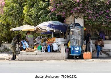 DAKAR, SENEGAL - APR 23, 2017: Unidentified Senegalese man sells goods beside the road  in Dakar, the capital and main city of Senegal