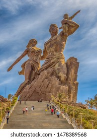 Dakar, Senegal - February 02, 2019: Images of a family at the African Renaissance monument, in the India Teranca Park near the coast. 'Monument de la Renaissance Africaine'. Africa