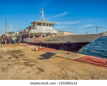 Dakar, Senegal - February 2, 2019: People waiting for the boat transporting people from Dakar to Goree island in port in Dakar. Gorée. Dakar, Senegal. Africa.