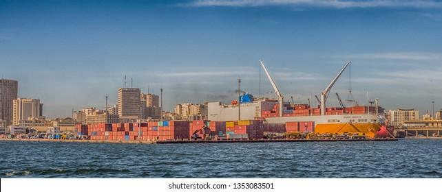 Dakar, Senegal - February 2, 2019: Panoramic view of the port of Dakar in Senegal with big ships, small boats, cranes and cargos near the quay. Africa.