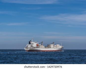 Dakar, Senegal - February 2, 2019: A large cargo ship sailed from the Dakar port in Senegal. Africa.
