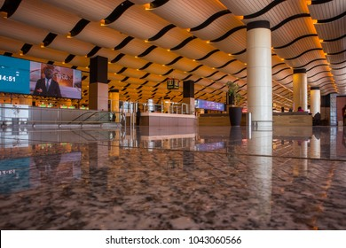DAKAR, SENEGAL, FEBRUARY 22 2018: Departure hall on the new Blaise Diagne airport in Dakar. Interior made of marble floor, pillars and wavy roof. Some LCD screens are visible.