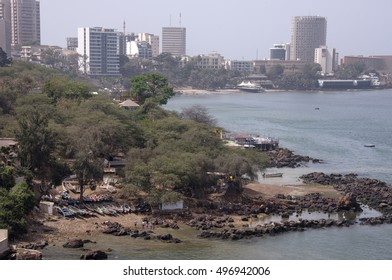 DAKAR, SENEGAL - JUNE 01, 2014: Fishing boats on the coast of the Corniche and skyline view of the city