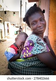 DAKAR, SENEGAL - MAY 15, 2015: A Senegalese mother and her shy son.