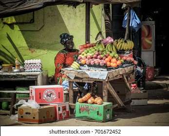 Dakar, Senegal - May 2011 - The streets of the suburbs of Dakar are populated by stalls selling all kinds of food. In this image it is a woman who sells fruit in her car