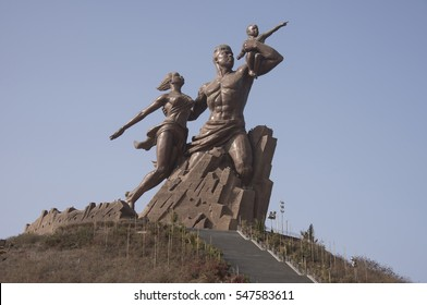 DAKAR, SENEGAL - MAY 27, 2014: Images of a family at the African Renaissance monument, in a park near the coast