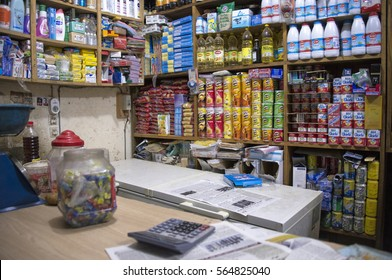 DAKAR, SENEGAL - MAY 27, 2014: Background of shelves with products and foreground of defocused counter, in a shop in a neighborhood of the city