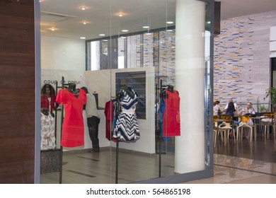 DAKAR, SENEGAL - MAY 27, 2014: View of a fashion shop and entrance to a restaurant, in a modern shopping center of the city