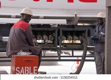 Dakar, Senegal - november 20, 2016: Workers loading gasoline with a tanker truck at a station on the outskirts of the city