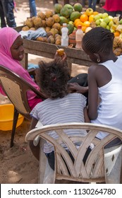 Dakar, Senegal - november 20, 2016: Group of children chatting behind the display of a fruit stand on the island of Goree