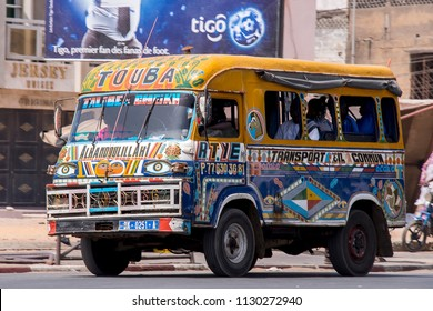 Dakar, Senegal - november 20, 2016: Image with motion blur of a typical transport bus, profusely decorated circulating through the streets of the city
