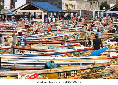 Dakar, Senegal - September 05, 2012: The Soumbedioune fish market in Dakar with the typical colourful fish-boat