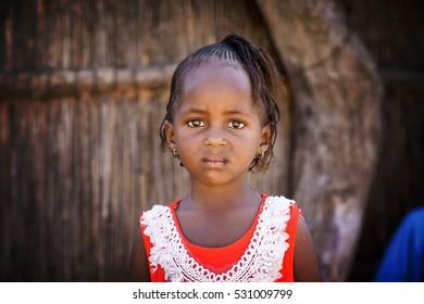 DAKAR/SENEGAL - NOVEMBER 13, 2013: Portrait of African little girl in the tribal village
