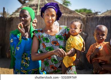 DAKAR/SENEGAL - NOVEMBER 13, 2013: Senegalese woman with her baby in a tribal village near Dakar, Senegal