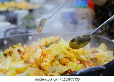 Dakgalbi : One of Korean favorite : Korean spicy stir fried vegetable, chicken and Korean spicy sauce (Gochujang) in big hot pan.