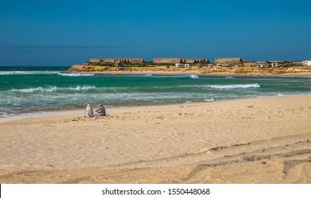 DAKHLA, MOROCCO, JAN 12, 2019: islamic women on the beach of Dakhla, Western Sahara, Morocco