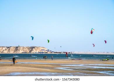 DAKHLA, MOROCCO, JAN 12, 2019: surfers on the Dakhla sea, Western Sahara, Morocco