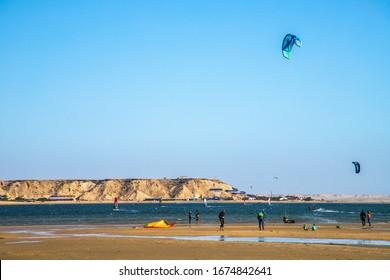DAKHLA, MOROCCO, JAN 12, 2019: surfers on the beach of Dakhla, little city in the Western Sahara, Morocco