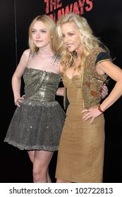"""Dakota Fanning and Cherie Currie  at """"The Runaways"""" Los Angeles Premiere, Cinerama Dome, Hollywood, CA. 03-11-10"""