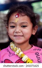 DAKSHINKALI, NEPAL - MAY 11:  Nepalese girl Anuya, 6, poses for a photo at Dakshinkali Temple on May 11, 2013 in Dakshinkali village, Kathmandu valley, Nepal.