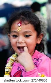 DAKSHINKALI, NEPAL - MAY 11:  Nepalese girl poses for a photo during Dakshinkali Festival on May 11, 2013 in Dakshinkali village, Kathmandu valley, Nepal.