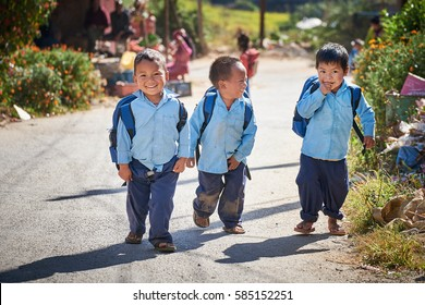 DAKSHINKALI/NEPAL - NOVEMBER 14, 2016: A group of happy nepalese school boys walking at the street.