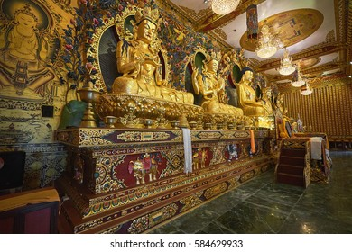DAKSHINKALI/NEPAL - NOVEMBER 14, 2016: Interior of the new buddhist monastery in Dakshinkali, Nepal. It is made in a traditional tibetan style with a lot of golden Buddha statues and decorations.