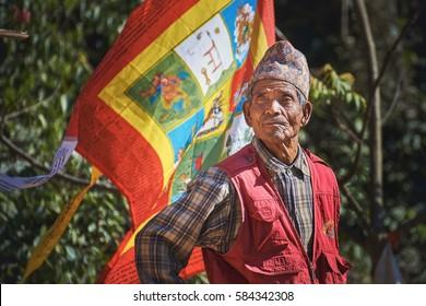 DAKSHINKALI/NEPAL - NOVEMBER 14, 2016: Portrait of a proud nepalese aged man with traditional dhaka topi hat.