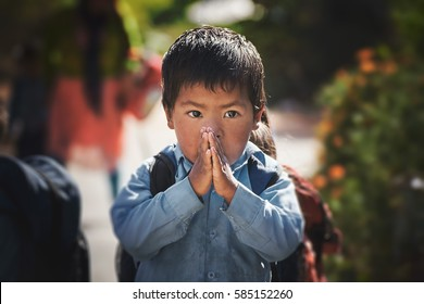 DAKSHINKALI/NEPAL - NOVEMBER 14, 2016: Portrait of a young nepalese boy with welcome clasped hands