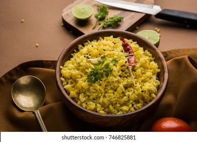 Dal khichadi or Khichdi Tasty Indian recipe served in bowl over moody background is made of toovar dal and rice combined with whole spices, onions, garlic and tomatoes etc. Selective focus
