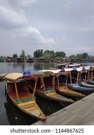 DAL LAKE, KASHMIR - JUNE, 2018: Boats called Shikara lining up waiting for the customers.