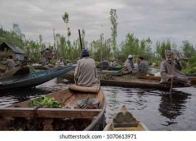 Dal Lake, Srinagar, Kashmir-April 12, 2018:Kashmir's Floating Vegetable Market at sunrise and cloudy. Most of the produce sold here is grown in floating gardens on the Dal Lake.