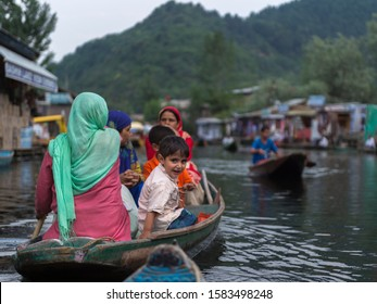 Dal Lake,Srinagar,Kashmir,India-July 01,2016: Local villagers commuting in a small boats in Dal lake,Srinagar,Kashmir,India
