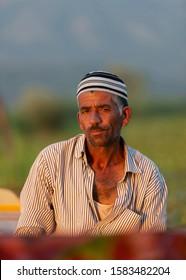 Dal Lake,Srinagar,kashmir,India-July17,2014: Portrait of a Local kashmiri Boat man at Dal Lake after Sunset,Srinagar,Jammu and Kashmir,India